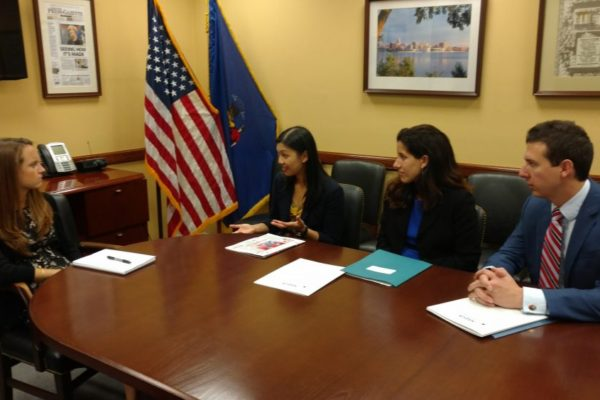 Yao Liu and Wisconsin representatives presenting project to Congressional representative